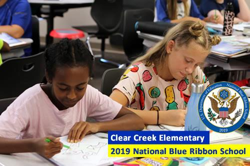 Photo of two students in classroom working at their desks; includes National Blue Ribbon 2019 logo.
