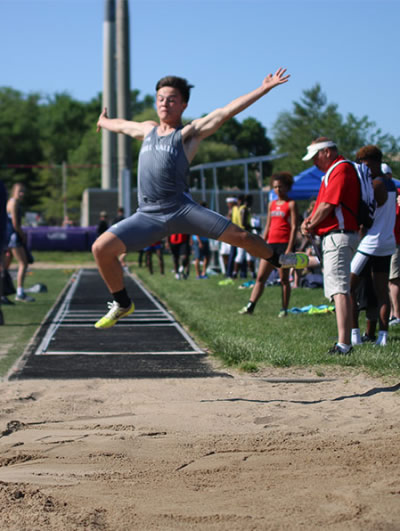 Image of Henry Lopez competing in the Long Jump