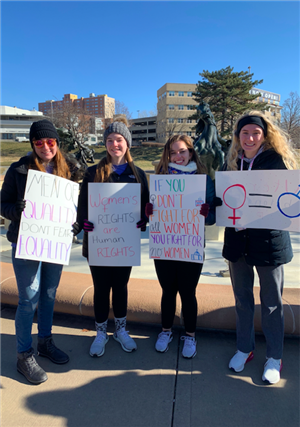 Members of the Women's Empowerment Club attend the women's march in Kansas City.