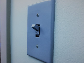 Image of light switch on wall